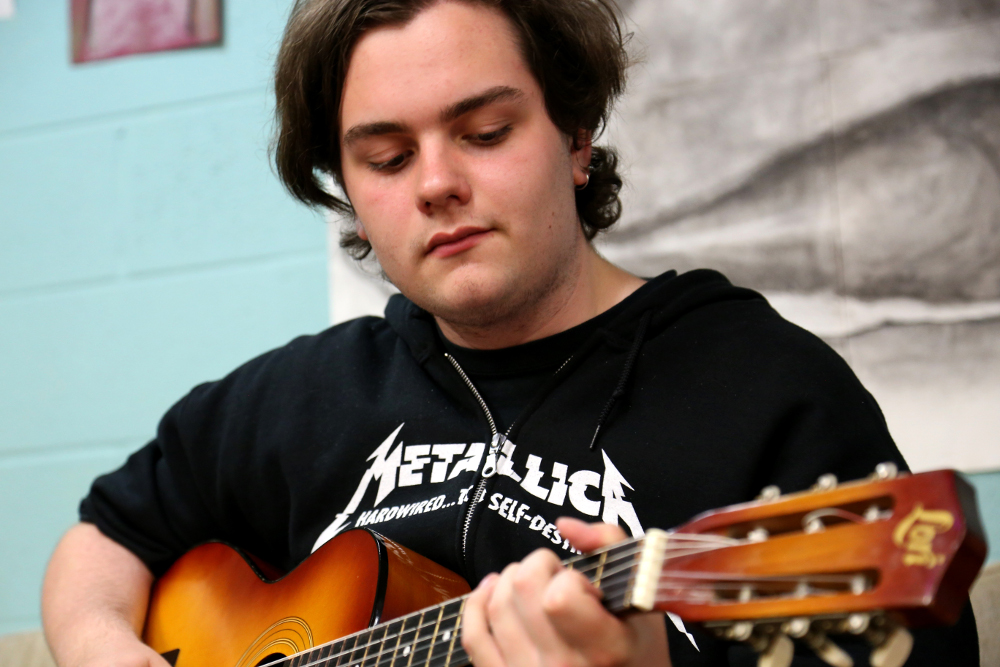 Jacob playing guitar
